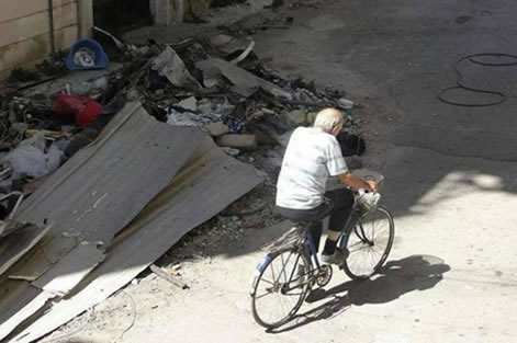 Fr. Frans was known for riding his bike around Homs, even after the war began.