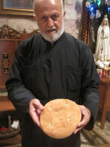 An Orthodox priest showing me the qurban (Eucharist) at an ancient church in Al-Salt, Jordan.
