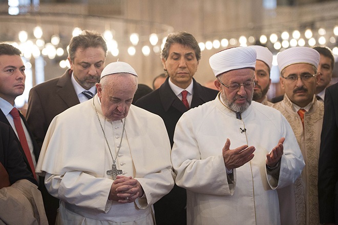 Pope Francis prays with Istanbul's grand mufti during visit to Sultan Ahmed Mosque in Turkey